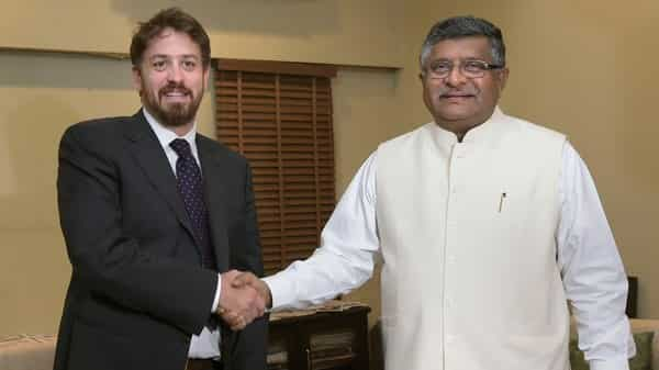 Union Minister for IT and Communication Ravi Shankar Prasad shakes hands with WhatsApp's global head Will Cathcart during a meeting at Sanchar Bhawan, New Delhi. Photo: PTI