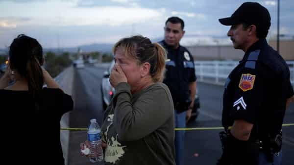 A woman reacts after a mass shooting at a Walmart in El Paso, Texas (Photo: Reuters)