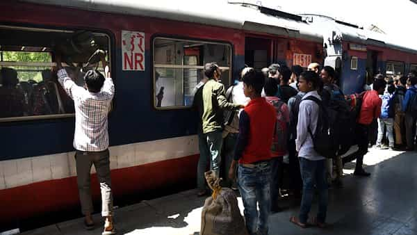 Passengers  board a train at Nowgam railway station in Srinagar, People of Kashmir are in panic following reports after Jammu and Kasmir Government issued an advisory to leave the Amarnath Yatris early in Jammu and kashmir.  (ANI )
