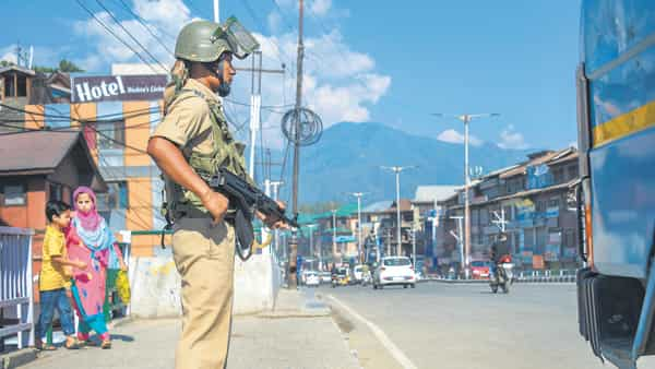 A CRPF jawan stands guard in Srinagar on Sunday in view of a terror threat in the state. (Photo: PTI)
