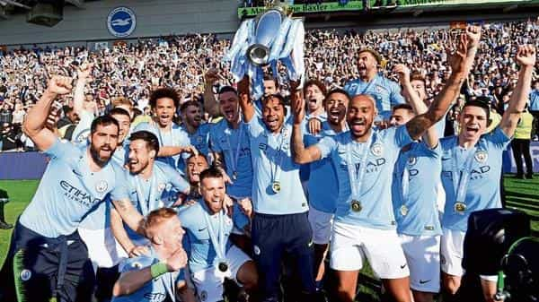 Manchester City players celebrate with the trophy (Reuters file)