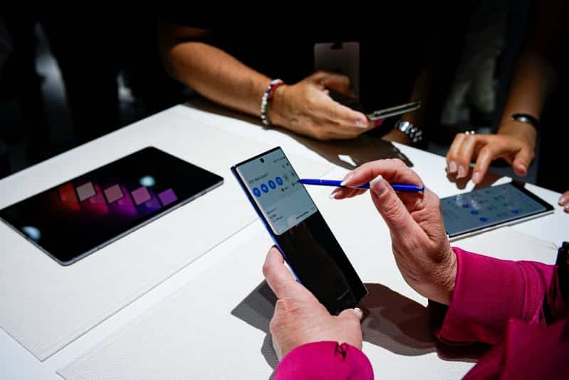 People test new devices during the launch event of the Samsung Galaxy Note 10 at the Barclays Center in Brooklyn. (Reuters)