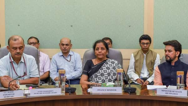 Union Finance Minister Nirmala Sitharaman flanked by MoS Finance Anurag Thakur (R) and Economic Affairs Secretary Atanu Chakraborty at a meeting in New Delhi (Photo: PTI)