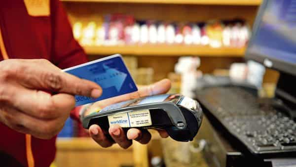 Firms are targeting retail merchants by integrating all payment form factors into a single smart PoS device. (Pradeep Gaur/ Mint)