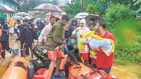 NDRF personnel conduct rescue operations in flood-hit areas in Karnataka's Kodagu on Sunday.  (Photo: PTI)