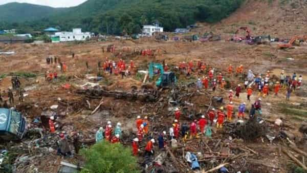 In this photo released by Myanmar Fire Service Department, members of a Myanmar rescue team work at a landslide-hit area in Paung township, Mon State, Myanmar (Photo; AP)