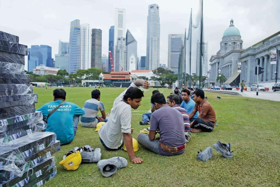 Migrant workers taking a break in the central business district.