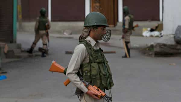 Indian paramilitary soldiers stand guard during security lockdown in Srinagar (Photo: AP)