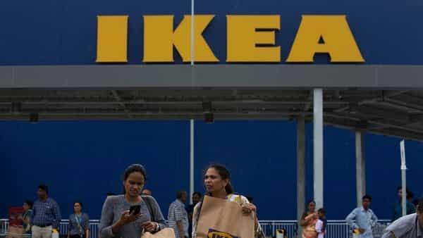 FILE - In this Aug.9, 2018, file photo, Indian customers return after shopping at IKEA's first store in India as it opened in Hyderabad, India. (AP)