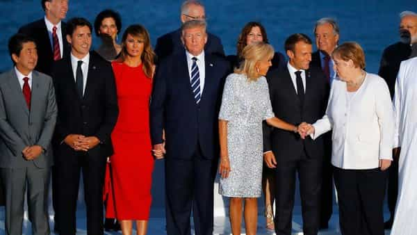 Biarritz: From the left, Japanese Prime Minister Shinzo Abe, Canadian Prime Minister Justin Trudeau, first lady Melania Trump, President Donald Trump, Brigitte Macron, French President Emmanuel Macron and German Chancellor Angela Merkel pose during the G7 family photo Sunday, Aug. 25, 2019 in Biarritz. A top Iranian official paid an unannounced visit Sunday to the G-7 summit and headed straight to the buildings where leaders of the world's major democracies have been debating how to handle the country's nuclear ambitions. AP/PTI(AP8_26_2019_000023B) (AP)
