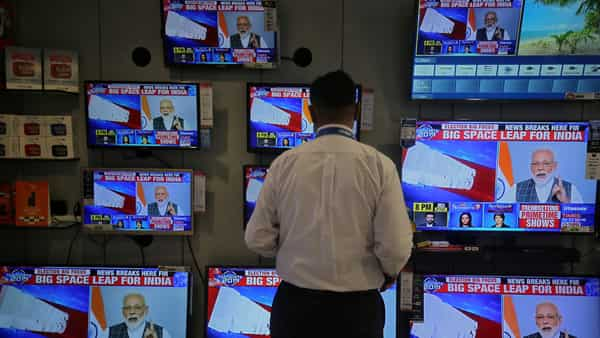 A salesman watches Prime Minister Narendra Modi addressing to the nation, on TV screens inside a showroom in Mumbai (File photo: Reuters)