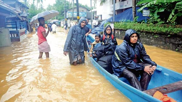 Locals being moved to safety during the floods in Kozhikode earlier this month. (Photo: PTI)