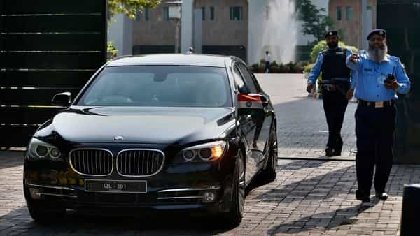 Islamabad: A vehicle carrying an Indian diplomat leaves the foreign ministry following a meeting with Kulbhushan Jadhav. (Photo: AP)