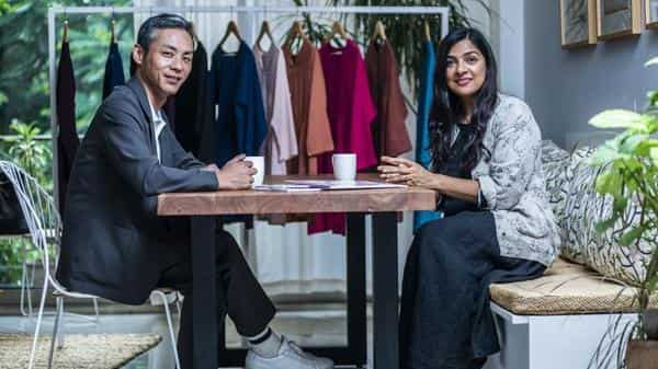 Uniqlo India CEO Tomohiko Sei with designer Rina Singh. The retailer has tied up with Singh to launch a kurta label in India (Photo: Pradeep Gaur/Mint)
