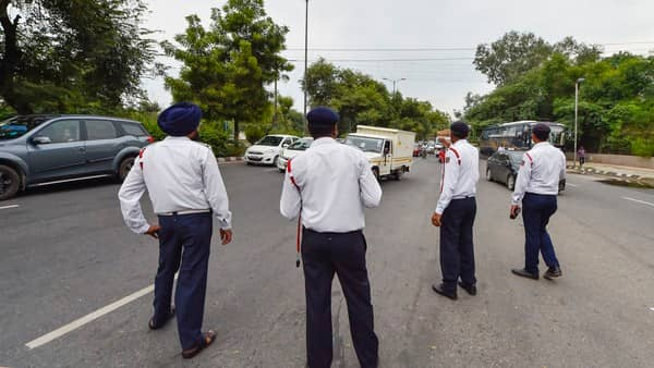Traffic policemen keep a vigil on road after the newly amended Motor Vehicles Act comes into force from 1 September, at Ring Road in New Delhi. (PTI )