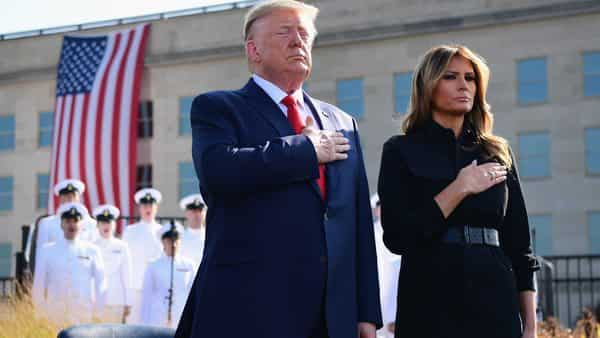 U.S. President Donald Trump and First Lady Melania Trump stand with hands over their hearts during a commemoration of the September 11 terrorist attacks at the Pentagon in Arlington, Virginia (Photo: Bloomberg)