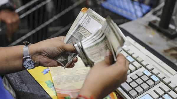 Rupee hits one-month high, zooms past 71-mark