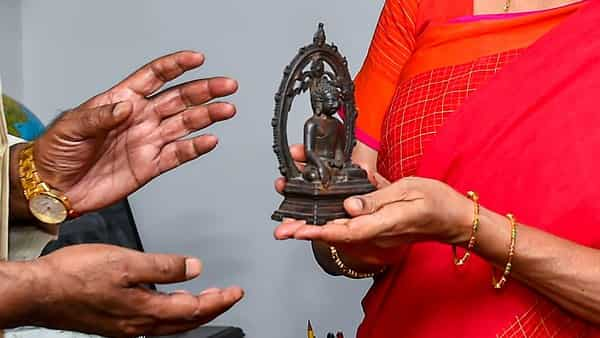 Union Finance Minister Nirmala Sitharaman hands over the 12th century Buddha statue, brought back from UK by DRI, to Union Minister of State (I/C) of Culture Prahlad Singh, in New Delhi (PTI)