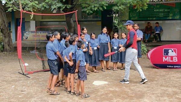 MLB India coach Avinash Kadam coaching children at Mumbai's Priyadarshini Vidyamandir school. (Photo: Jaideep Vaidya)