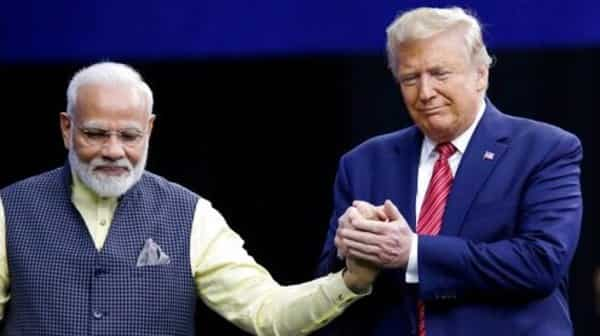 Prime Minister Narendra Modi and President Donald Trump shake hands after introductions during the 'Howdi Modi' event Sunday, Sept. 22, 2019, at NRG Stadium in Houston. Photo: AP