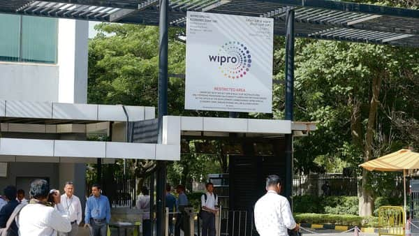 At 1150 AM on the NSE, Wipro shares traded 1% higher at  ₹241.50 (Mint file)