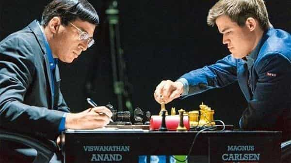 Viswanathan Anand (left) and Magnus Carlsen. Anand believes that failures sometimes teach us more than success (AP file)