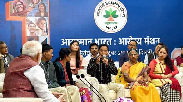 Prime Minister Narendra Modi interacting with the select beneficiaries of AB-PMJAY, in New Delhi (File photo: ANI)