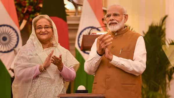 PM Narendra Modi with his Bangladeshi counterpart Sheikh Hasina during the launching a bilateral project at Hyderabad House in New Delhi on Saturday (Photo: PTI)