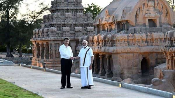 China's President Xi Jinping shakes hands with India's Prime Minister Narendra Modi during their visit to the Pancha Rathas complex in Mamallapuram on the outskirts of Chennai (Photo: PIB)