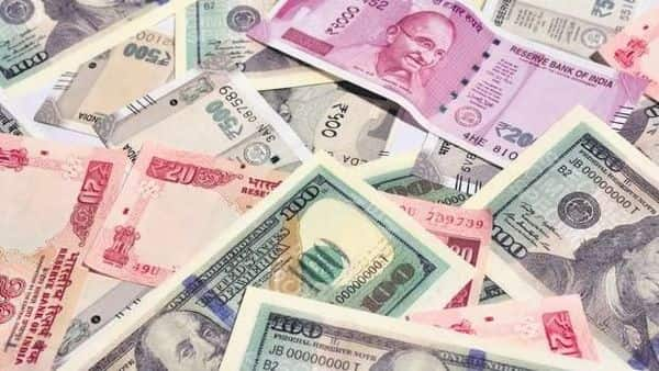 Rupee opens flat as investors remain cautious on global cues and RBI minutes