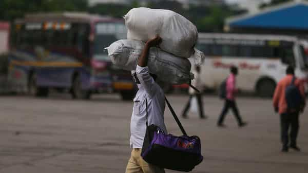 A passenger walks with his luggage at a bus terminal after transportation was disrupted following a shutdown strike by TSRTC and opposition political parties in Hyderabad. (Photo: AP)