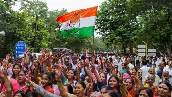 Congress supporters celebrate party candidate's Vikas Thackeray's victory in Assembly elections, in Nagpur. (PTI)