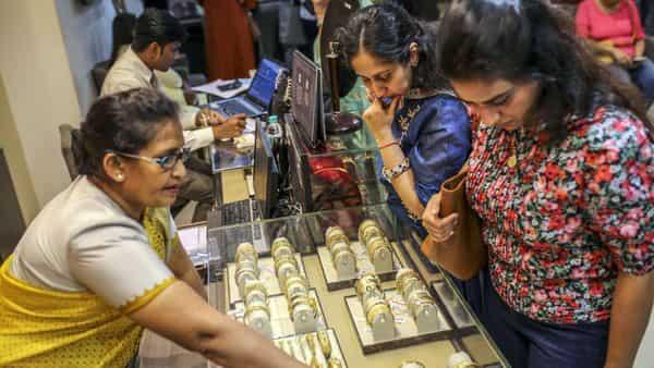 Customers browse gold bangles inside a Titan Co. Tanishq jewelry store during the festival of Dhanteras in Mumbai (Photo: Bloomberg)