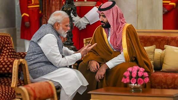 Prime Minister Narendra Modi with Saudi Arabia's Crown Prince Mohammed bin Salman