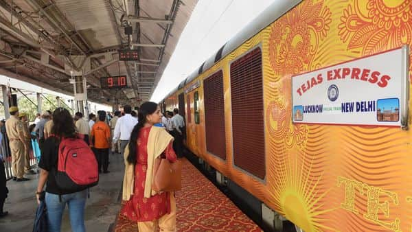 Lucknow: Passengers near the Lucknow-Delhi Tejas Express, India's first 'private' train by IRCTC (Indian Railway Catering and Tourism Corporation), during its flag-off ceremony at the Charbagh Railway station in Lucknow, Friday, Oct. 4, 2019. (PTI Photo/Nand Kumar) (PTI10_4_2019_000067A) (PTI)