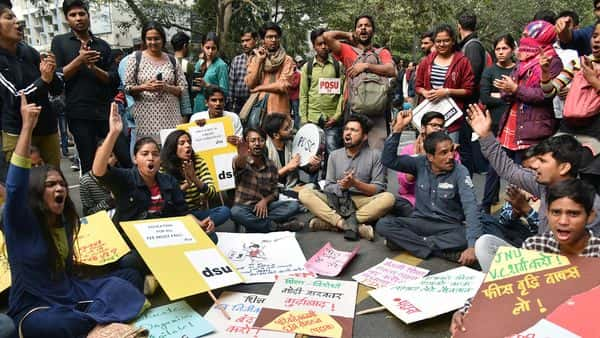 JNU students sit on the street and shout slogans during a protest against the proposed fee hike in Jawaharlal Nehru University (Photo: ANI)