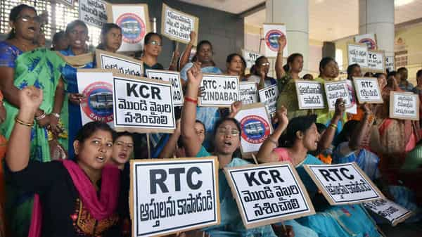 TSRTC employees and their family members during a protest at Mahathma Gandhi Statue in Hyderabad.  (ANI )