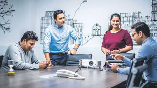 Madhvi Walia, who founded Tracecost Inc. with Prabh Paul (in blue shirt, standing), says if a relationship becomes too friendly, a line of decorum is crossed. (Photo: Pradeep Gaur/Mint)
