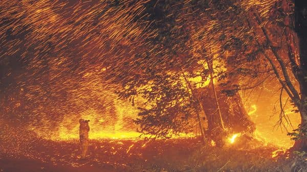 A photographer documents a California wildfire in October. (Photo: Getty Images)