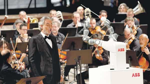 Robots are getting smarter in the way they sense, move and adapt. In 2017, humanoid robot YuMi conducted the Lucca Philharmonic Orchestra, performing alongside tenor Andrea Bocelli at the Verdi theatre in Italy. (Reuters)