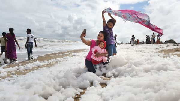 Image result for Children play as 'toxic' foam blankets Indian beach