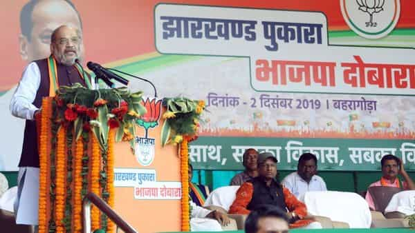 Union Home Minister and BJP National President Amit Shah speaks at a Jharkhand election rally in Baharagora on Monday. BJP faces a tough fight in Jharkhand. At stake is its national footprint and ambitions to dominate the Rajya Sabha (Photo: ANI)