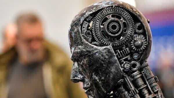 A metal head made of motor parts symbolizes artificial intelligence.  (AP)