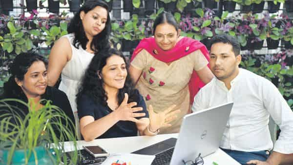 CarveNiche's Avneet Makkar (seated, centre) with her team at the Bengaluru office
