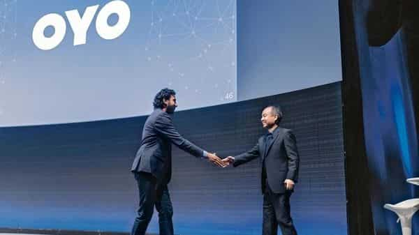 SoftBank founder Masayoshi Son (right) has been known to say that he sees Oyo's Ritesh Agarwal as a 'son' (Photo: Alamy)