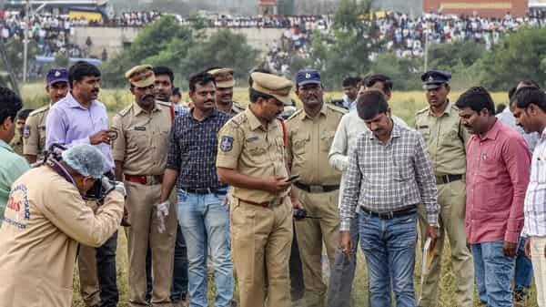 A file photo of forensic experts collect evidence from the spot where police shot dead four accused in the rape-and-murder case of a 25-year-old woman veterinarian (Photo: PTI)
