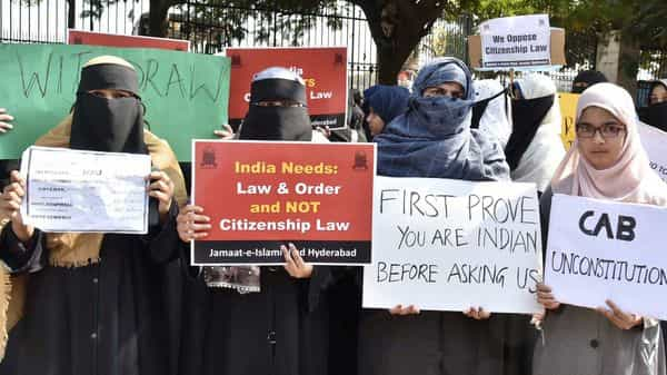 Members of the Muslim community hold placards during a Protest against the CItizenship Amendment Act and NRC, at Indira Park in Hyderabad on Sunday (Photo: ANI)
