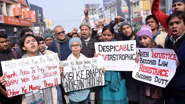 Protesters holding placards as they raise slogans during a demonstration against NRC and Citizenship (Amendment) Act at Bihar Bandh, in Patna on Saturday. (ANI)