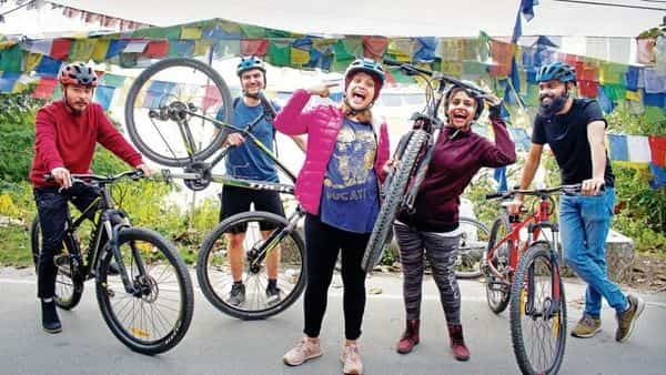 Manisha and Bhavna Sharma (centre), who organize an annual cycling ride along the ancient Silk Route in Sikkim, with their guests from Tagalong Hostel in Gangtok. (Photo: Rudra Subba/Mint)