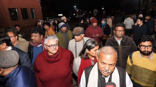 JNU faculty members and students after some masked miscreants attacked inside the campus, New Delhi, Sunday (Photo: PTI)